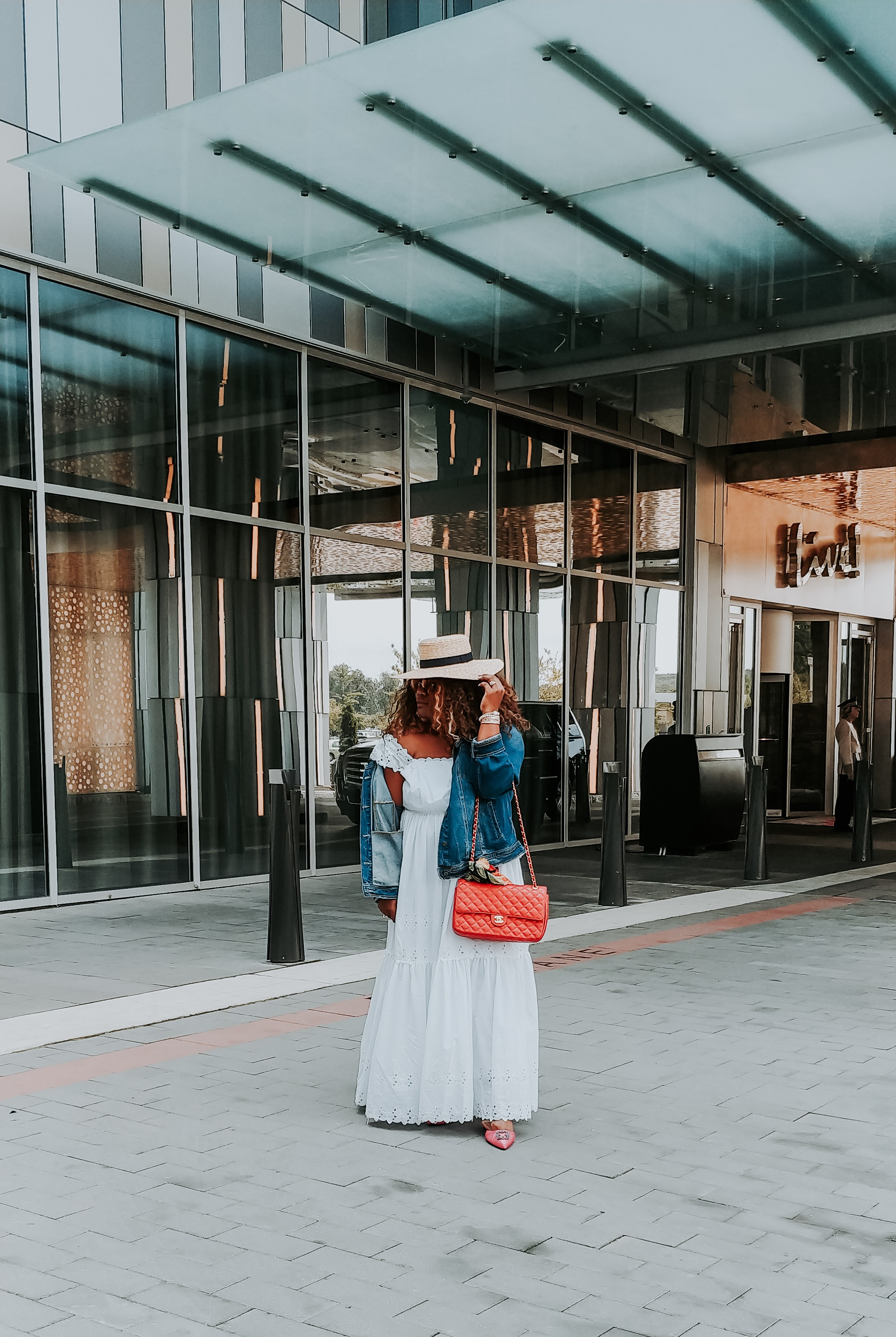 girl with a white dress and hat on posing outside - alwayscreatingblog.com